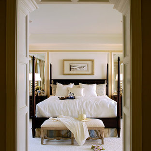 Example of a classic carpeted bedroom design in Baltimore with yellow walls