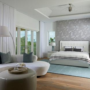 Bedroom - contemporary master light wood floor bedroom idea in Miami