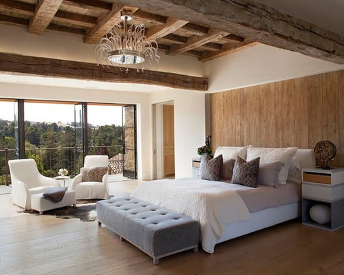 tuscan master bedroom photo in san francisco with white walls and medium tone hardwood floors - Brown And White Bedroom Ideas