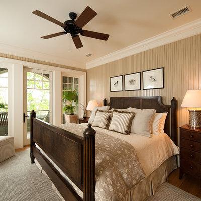 Bedroom - mid-sized traditional guest medium tone wood floor bedroom idea in Charleston with beige walls