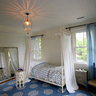 Example of a classic bedroom design in Bridgeport with beige walls