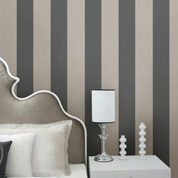 Stripes by Chesapeake - This stylish bedroom look features a plush velvet headboard, white fur pillows and a contemporary side table. A textured wallpaper of a black and grey stripe looks sleek and sophisticated on walls.