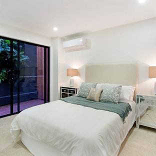 Inspiration for a contemporary bedroom in Brisbane with white walls, carpet and beige floor.