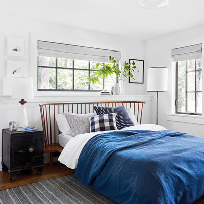 Example of a country bedroom design in Portland with white walls and no fireplace