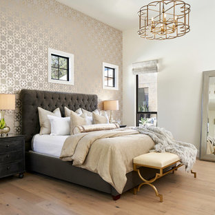 Inspiration for an expansive traditional master bedroom in Other with light hardwood floors and multi-coloured walls.