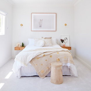 Inspiration for a mid-sized modern carpeted and white floor bedroom remodel in Sydney with white walls and no fireplace