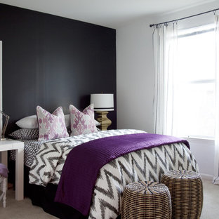 Eclectic bedroom photo in Atlanta with black walls