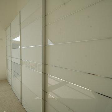 Stylish sliding door wardrobe in contemporary new build.