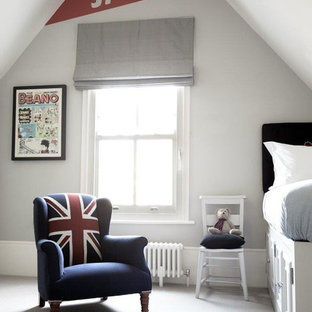 Inspiration for a mid-sized timeless guest carpeted and gray floor bedroom remodel in London with gray walls and no fireplace