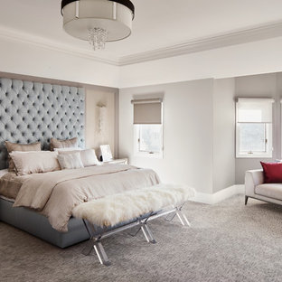 Example of a large trendy master carpeted bedroom design in Chicago with gray walls and no fireplace
