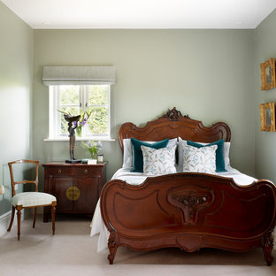 Traditional bedroom in Other with green walls, carpet and beige floors.