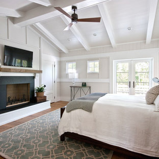 Inspiration for a traditional bedroom in Charleston with white walls.