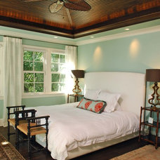 Tropical Bedroom by Phillip W Smith General Contractor, Inc.