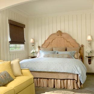 Diseño de dormitorio marinero, sin chimenea, con paredes blancas y suelo de pizarra