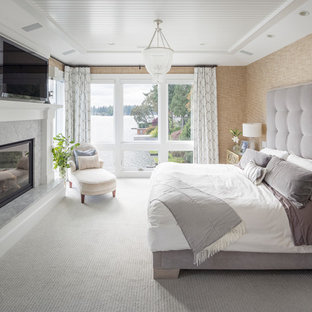 Bedroom - transitional carpeted and gray floor bedroom idea in Portland with beige walls, a standard fireplace and a stone fireplace
