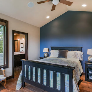 Inspiration for a rustic master dark wood floor and brown floor bedroom remodel in Seattle with beige walls