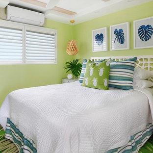 Design ideas for a beach style bedroom in Hawaii with grey walls, medium hardwood floors and brown floor.