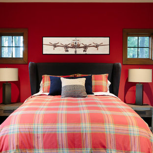Example of a mid-sized mountain style guest carpeted bedroom design in Seattle with red walls and no fireplace