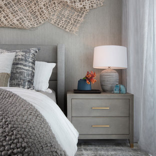 Example of a trendy guest carpeted and gray floor bedroom design in Miami