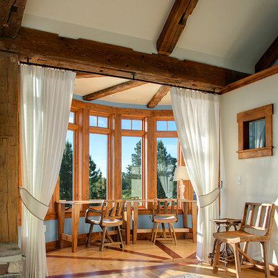 Elegant medium tone wood floor bedroom photo in Seattle with white walls