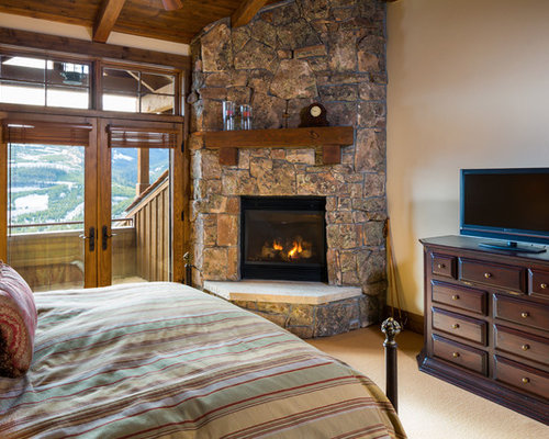 Luxury bedroom design ideas renovations photos with a for Master bedroom corner fireplace