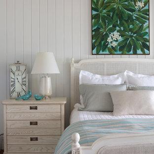 Bedroom - tropical dark wood floor and brown floor bedroom idea in Orange County with white walls