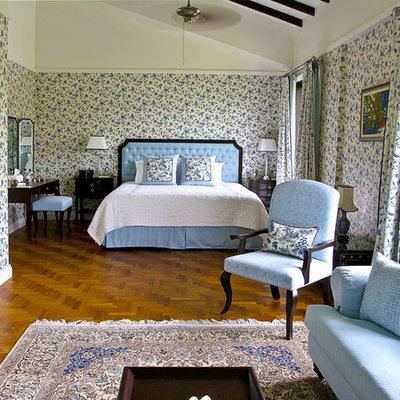 Elegant medium tone wood floor bedroom photo in Singapore with yellow walls