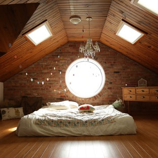 Example of a transitional medium tone wood floor and orange floor bedroom design in Melbourne with white walls