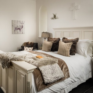 Inspiration for a mid-sized country guest bedroom in Other with white walls, slate floors and grey floor.
