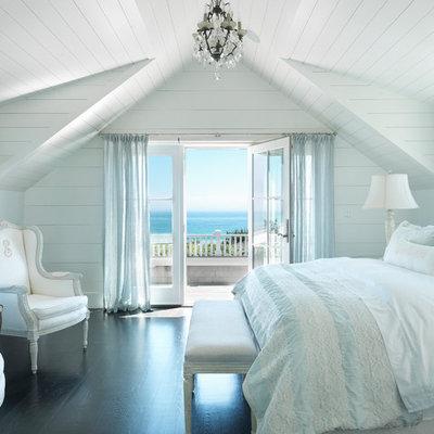 Beach style dark wood floor bedroom photo in Boston with white walls