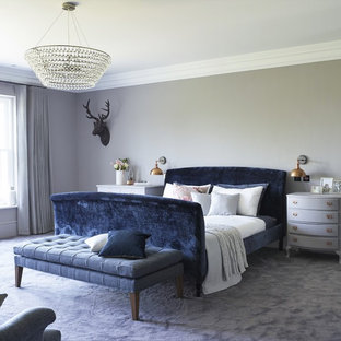 Example of a transitional blue floor bedroom design in Surrey