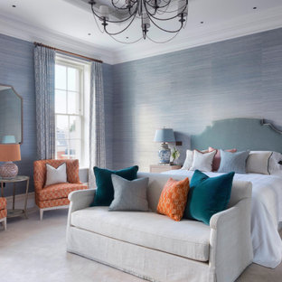 Design ideas for a classic master bedroom in Surrey with blue walls, carpet, grey floors and wallpapered walls.
