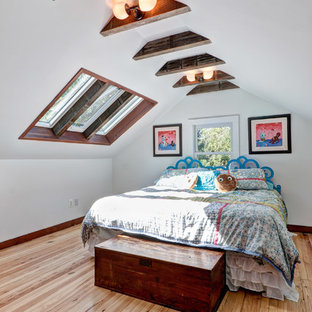 Inspiration for a craftsman light wood floor bedroom remodel in Philadelphia with white walls