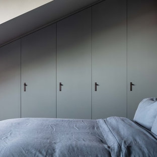 Photo of a medium sized scandi guest bedroom in London with grey walls.