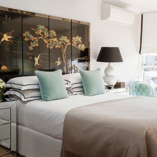 Elegant bedroom photo in Sydney with white walls