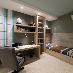 Photo of a contemporary bedroom in Other with grey walls and carpet.