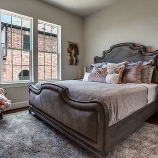 Example of a transitional guest dark wood floor and brown floor bedroom design in Dallas with beige walls