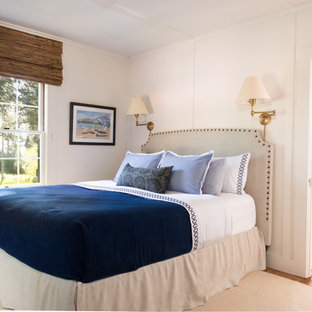 Large mountain style master medium tone wood floor and brown floor bedroom photo in Sacramento with white walls