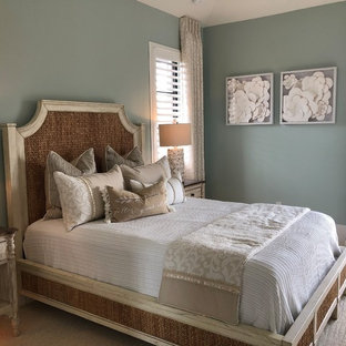 Example of a cottage chic carpeted and beige floor bedroom design in Miami with blue walls