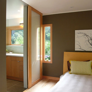 Design ideas for a large asian master bedroom in San Francisco with brown walls, light hardwood floors, no fireplace and beige floor.