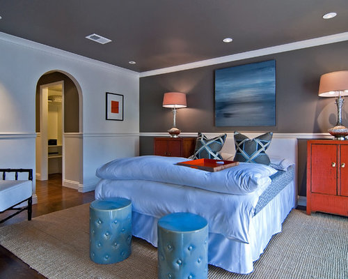 gray and red bedroom. trendy master dark wood floor bedroom photo in san francisco with gray walls and red r