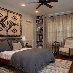 Large transitional master dark wood floor bedroom photo in Austin with gray walls