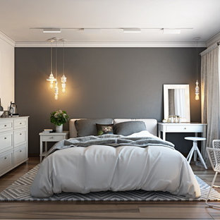 This is an example of a small contemporary guest bedroom in New York with grey walls, linoleum floors and no fireplace.
