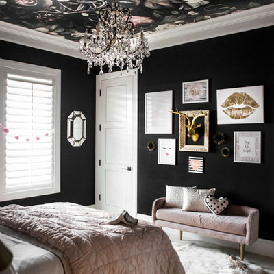 Example of a mid-sized eclectic carpeted bedroom design in Boise with black walls