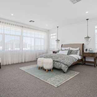 Large transitional bedroom in Perth with white walls, carpet and grey floor.