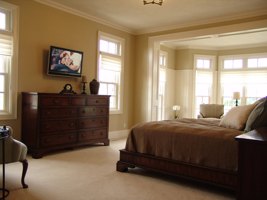 Television Installation in Master Bedroom with Seating Area