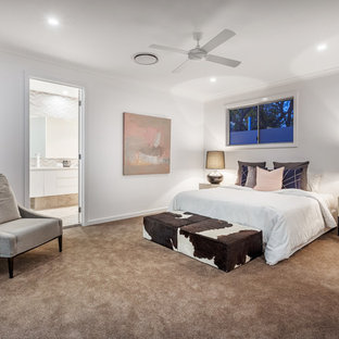 Contemporary master bedroom in Brisbane with white walls, carpet and beige floor.