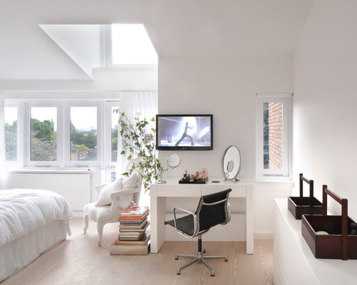Large Scandinavian Master Light Wood Floor Bedroom Idea In London With  White Walls