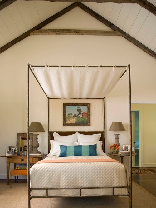 Ex&le of a large country dark wood floor bedroom design in New York with white walls & Ceiling Canopy | Houzz