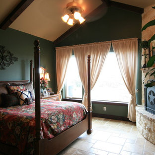 Design ideas for a large traditional master bedroom in Austin with green walls, travertine floors, a corner fireplace, a stone fireplace surround and brown floor.